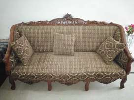 7 seater sofa with table 5 months used make on order with solid wood.