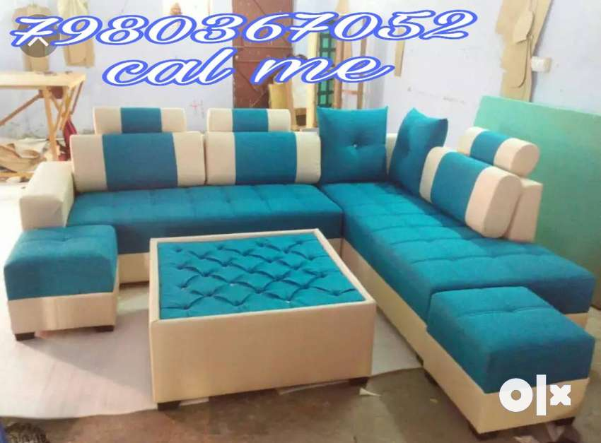 Brand new corner sofa set with extra puffy and center table in blue co 0