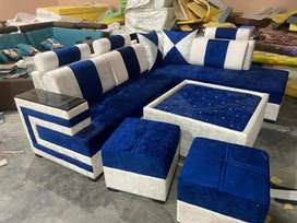 L shape sofa set with 2 puffies and 1 centre table