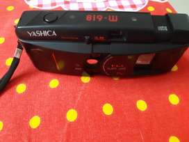 it is a Yashica camera. it is black in colour and