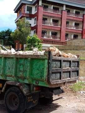 Jasa buang Puing Di Negara Melaya 24 jam Dam Truck