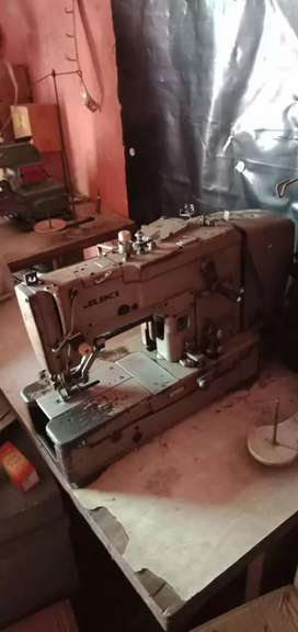 Button hole and buttons attaching machine
