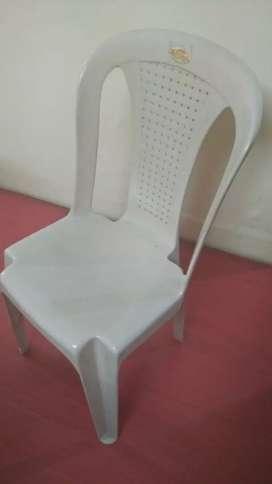 Ten Plastic chairs.