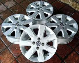 jual pelek nissan march ring15x5 pcd4x100 silver