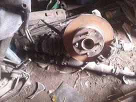 Nissan Sunny front shocks, drums, leather, axles, steering box etc
