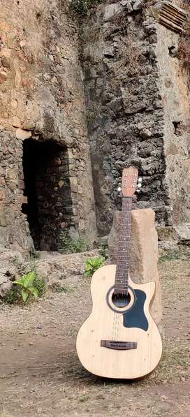 Handcrafted solid wood Acoustic Guitars