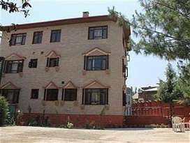 CommercialBuilding available:  10rooms with attached bathroom,3 floors
