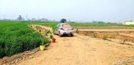 2700 rupees plots for sale near Rishi colony back side Neelima vihar .