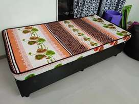 Single wooden bed 6*4 feet with storage and mattress.