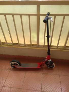 Scooter with two brakes in it red rough surface so that don't fall