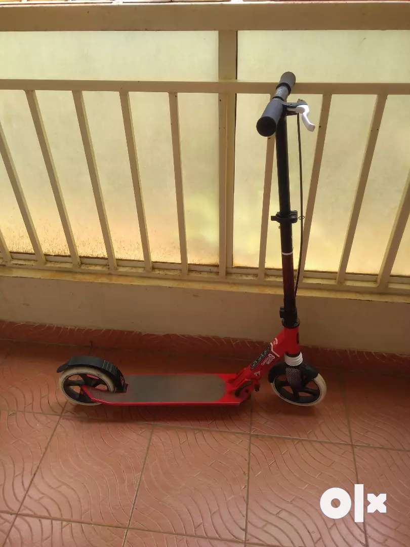 Scooter with two brakes in it red rough surface so that don't fall, 0