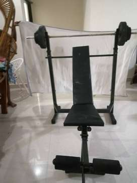 workout bench and weight bar home gym equopment