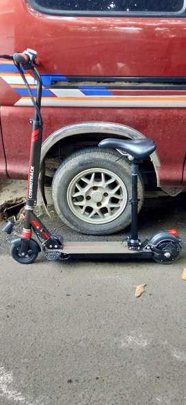 scooter listrik cosmotrack