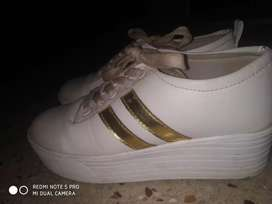 White shoes with golden strips