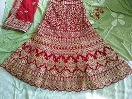 Red Vellvet Bridal lehenga for sale