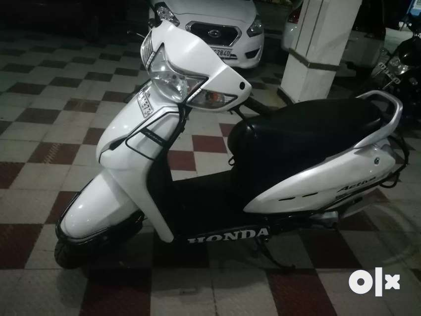 A brand new like well maintained white activa for sale 0
