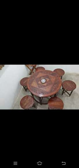 Round-table with six folding stool