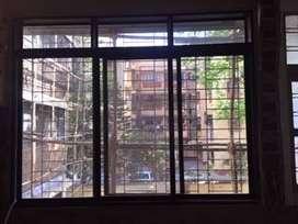 Aluminium Sliding Windows with Anti-Glare Glass and Brown Powder Coat