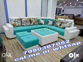 Brand new 6 seater sofa set in navy blue color with table and puffy