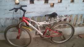 biycle for sale in good condition with shark absorbance red color