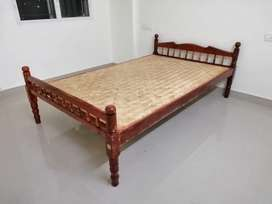 Wooden cot available