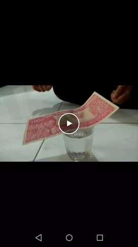 Uang 1000 lama yang bisa melengkung sendiri jika kenak suhu badan