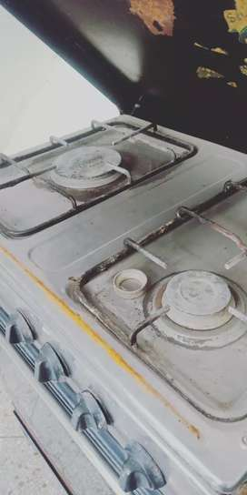 Three stove cooking range with iron stand