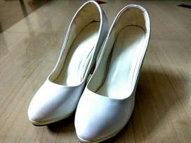 white heels for party wear or a wedding wear.