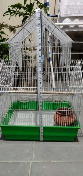 Bird cage with a pot.