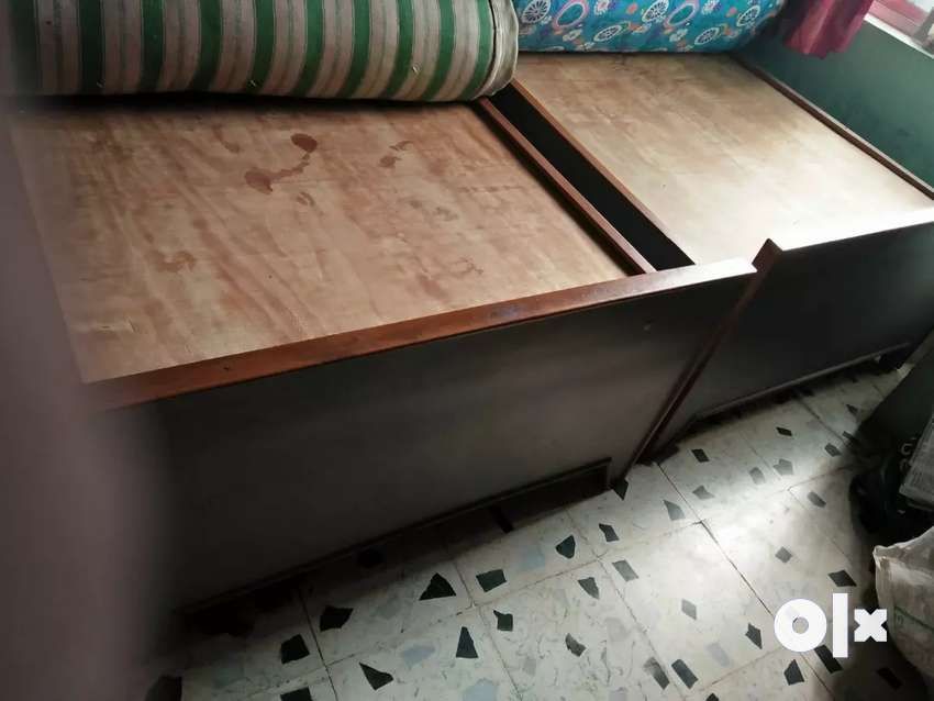 2 No.s wooden beds with storage capacity 0
