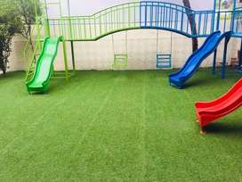 Artificial grass for playing areas, astro turf