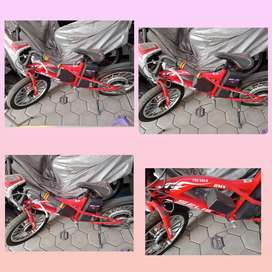 Sepeda thunder selis listrik merah