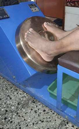 Rotating kasya thali foot massaging machine