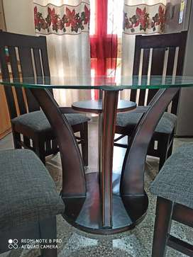 4 seater glass top wooden dinning table in a fabulous condition.