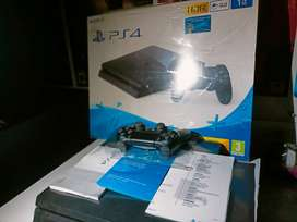 PS4 slim 1TB like new Excellent box pack condition 7 games installed