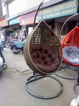 garden swing with cushion
