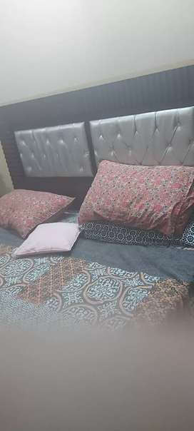 Bed with soft matress and dressing table with two side table