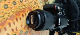 Nikon D3300 with kit lens and 55-200mm lens