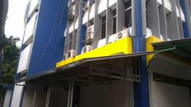 pengecatan gedung dan pembersihan kaca gedung