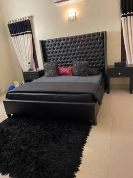 Complete  Bedroom set with rug and curtains and wardrobe.
