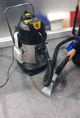 Vacuum Cleaner with Spray