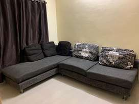 L-shaped sofa with 5 cushions, grey color