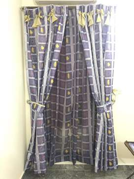 Blue curtains. They are double curtains.