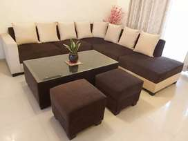 L-Shaped 8 seater sofa  with 2 puffies and center table