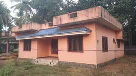 MELOOR near CHALAKUDY 10 cents original land tarring frontage.