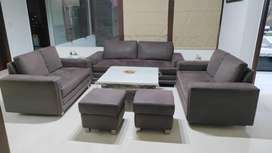 7 seater sofa with 2 puffees