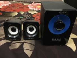 Two Black-and-blue Speakers.