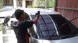 Bengkel pemasangan kaca film mobil dan gedung