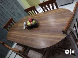 A 5-year old teak wood 6 seater dining table with chairs is available
