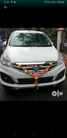 Sanitised Ertiga available on rent at reasonable price